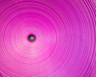 Círculos púrpuras concéntricos, textura plástica foto de archivo libre de regalías