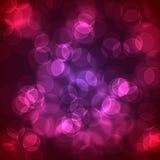 Círculos que brillan intensamente abstractos en un fondo colorido Foto de archivo libre de regalías