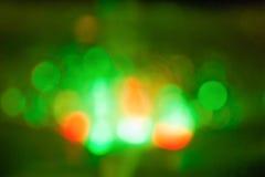 Círculos verdes, alaranjados abstratos do bokeh imagem de stock