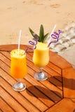 Jugo de la piña, del mango y de la fruta de la pasión Foto de archivo libre de regalías