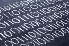 Código binário no quadro-negro Fotografia de Stock