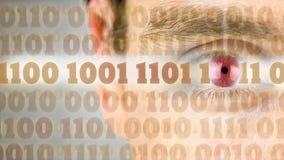 Código binario con el ojo humano imagenes de archivo