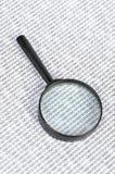 Código binario y lupa Imágenes de archivo libres de regalías