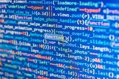Código del Javascript en software del soporte Programador Typing New Lines del código del HTML fotos de archivo libres de regalías