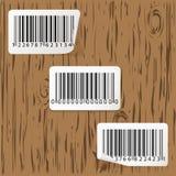 Códigos de barras en el fondo de madera Fotos de archivo libres de regalías