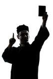 Cólera del sacerdote del hombre de la silueta de dios Foto de archivo
