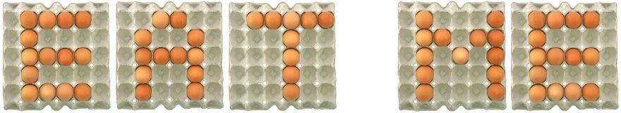 CÓMAME palabra de los huevos en la bandeja del papel Foto de archivo libre de regalías