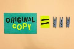 Cópia do original do texto da escrita Conceito que significa igual patenteado marcado Unprinted do lembrete do papel de turquesa  foto de stock royalty free