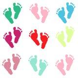 Cópias coloridas do pé do bebê Fundo do cumprimento do bebê da festa do bebê Imagem de Stock Royalty Free