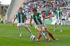 CÓRDOBA, ESPAÑA - 17 DE MARZO: Vincenzo Rennella W (12) en la acción durante la liga Córdoba del partido (W) contra Almería (r) (4 Imágenes de archivo libres de regalías