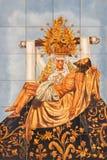Córdova - o Pieta telhado cerâmico na fachada da igreja Iglesia de San Agostinho Fotografia de Stock