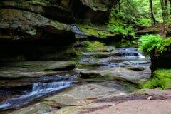 Córrego através da caverna de homem idoso Foto de Stock Royalty Free