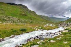 Córrego do rio de Moiry no vale Fotos de Stock Royalty Free