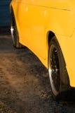 Côté d'une automobile jaune Image stock