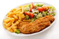 Côtelette de porc frite et pommes frites Photos stock