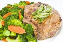 Côtelette et broccoli de porc d'ail Image libre de droits