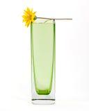 c花玻璃绿色简单的花瓶黄色 免版税图库摄影