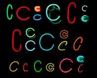 c помечает буквами неон Стоковая Фотография