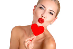 C Beautiful woman bright makeup and red heart stock photo