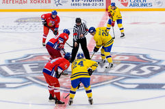 C. Berglund (22) and M. Hostak (20) on face-off Stock Photos