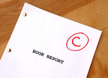 C Book Report. A book report on a desk with an average grade Royalty Free Stock Photos