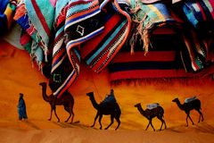 C&C camel and carpet. Camel wall painting under pile of carpets Stock Photos