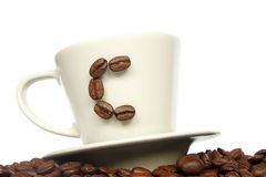 C For Coffee. Coffee cup with coffee bean C on coffee wave Stock Photos