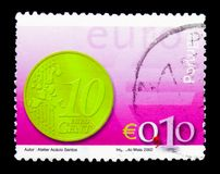 10c coin, Introduction of the Euro serie, circa 2002. MOSCOW, RUSSIA - MARCH 28, 2018: A stamp printed in Portugal shows 10c coin, Introduction of the Euro serie royalty free illustration