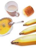 C'est ensemble de petit déjeuner se composent du lait d'amande, soupe à potiron, bana Image libre de droits