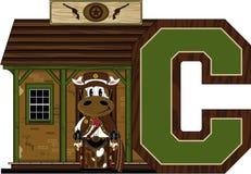 C est pour le cowboy Cow Image stock