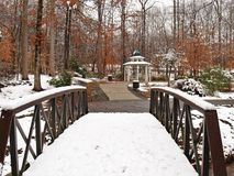 C. G. Hill Memorial Park. The remains of a snowfall stand along the banks and on the treetops at C. G. Hill Memorial Park in Winston-Salem, North Carolina stock image