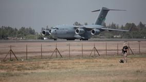 C-17 Globemaster. Large military transport plane US Air Force C-17 Globemaster jet getting ready for departure stock footage