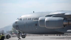 C-17 Globemaster. Large military transport plane US Air Force C-17 Globemaster jet getting ready for departure stock video footage
