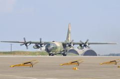 C130H Hercules. Military transport aircraft is taxiing on the runway Royalty Free Stock Photography