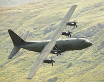 C130 Hercules aircraft. Low level C130 Hercules military aircraft Royalty Free Stock Photo