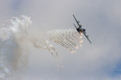 C-130 Hercules firing off flares Royalty Free Stock Photo
