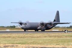 C-130 Hercules military transport plane. A c-130 Hercules military transport plane on the ground, ready for take off Stock Photos