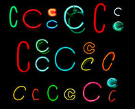 c letters neon Arkivbild