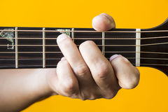 C major chord on guitar. Hand performing C major chord on guitar Royalty Free Stock Image