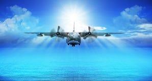 C123 military plane landing. With blue sky sun shine background Stock Photo
