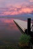 C; oudscape over de visserijpijler bij zonsondergang Stock Afbeelding