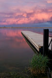 C;oudscape over the fishing Pier at sunset. Fishing Pier on a Colorado Lake at sunset with Pink Clouds stock image