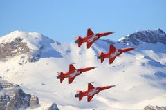C-Series and Swis-Airforce performing a Air show at Lauberhorn ski world cup. Lauberhorn/ Schwitzlerand january 17, 2018: Siwss C-Series and Swis-Airforce royalty free stock photo