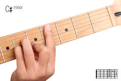 C sharp minor guitar chord tutorial. C#m - basic minor keys guitar tutorial series. Closeup of hand playing C sharp minor chord on guitar, isolated on white Stock Photo