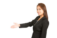 Côté asiatique de sourire d'offre de poignée de main de salutation à H Images stock