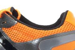 Côté orange de chaussure de course Images libres de droits