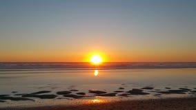 Côte du nord-ouest de coucher du soleil de plage de l'Orégon Images libres de droits