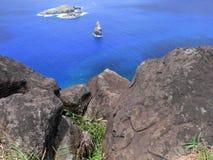 Côte volcanique sauvage de sud-ouest d'île de Pâques Photo stock