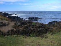 Côte volcanique sauvage de sud-ouest d'île de Pâques Photographie stock