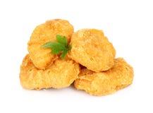 Côtelettes de poulet frit sur un fond blanc Photo libre de droits
